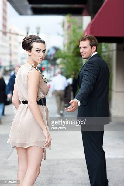 Beautiful Young Couple, Woman Looking Back Over Shoulder
