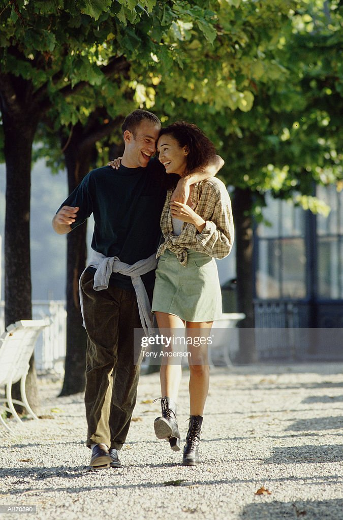 Young couple walking in park : Stock Photo