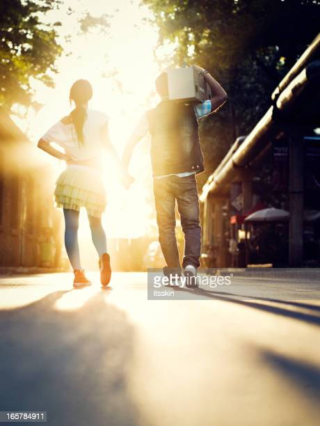 Young couple  walking in the sunrays
