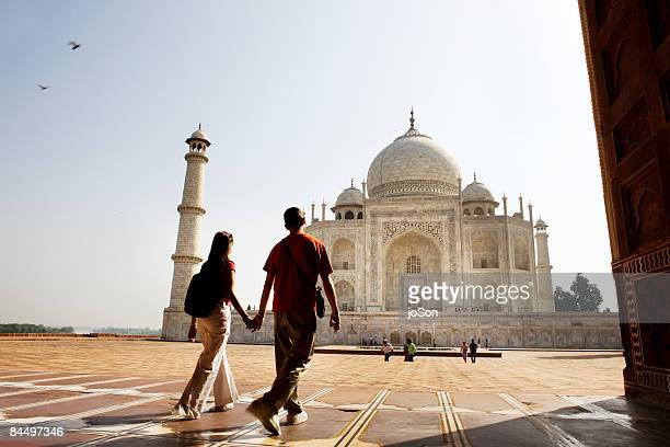 Young couple walking in the Taj Mahal courtyard