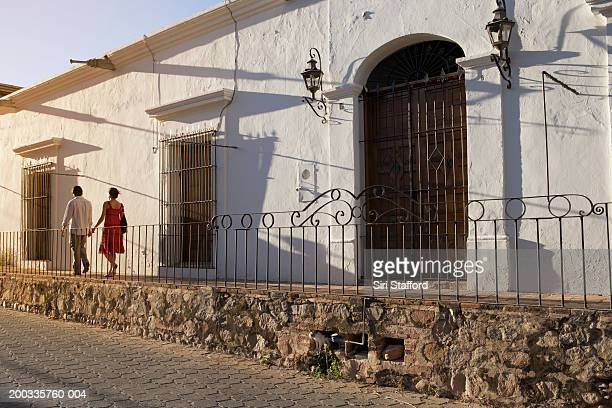 Young couple walking on balcony, Alamos, Mexico