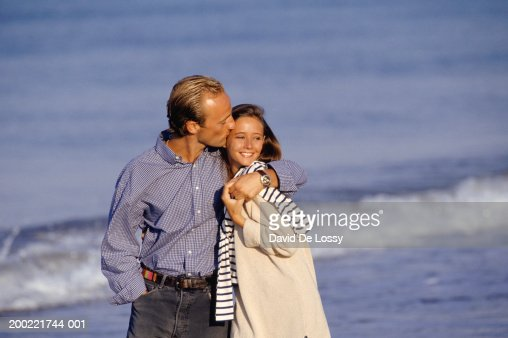 Young couple walking on beach : Stock Photo