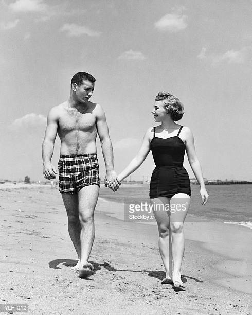 Young couple walking on beach