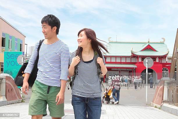 Young couple walking through town