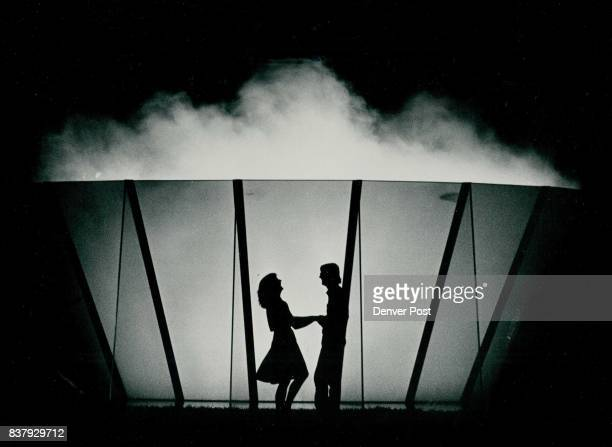 A young couple was caught in silhouettes in front of Denver's new solar fountain on DCPA grounds this weekend This two spent sometime conversing...
