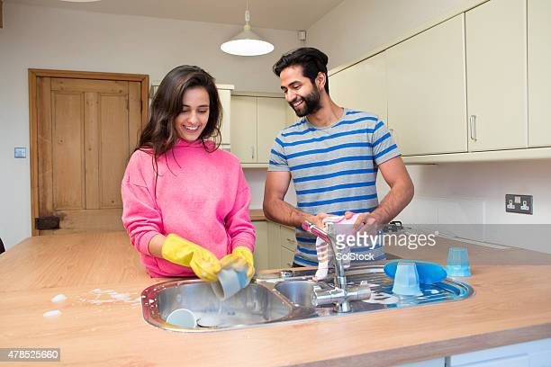 Young Couple Washing Dishes Together