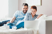 Young couple watching content on the laptop