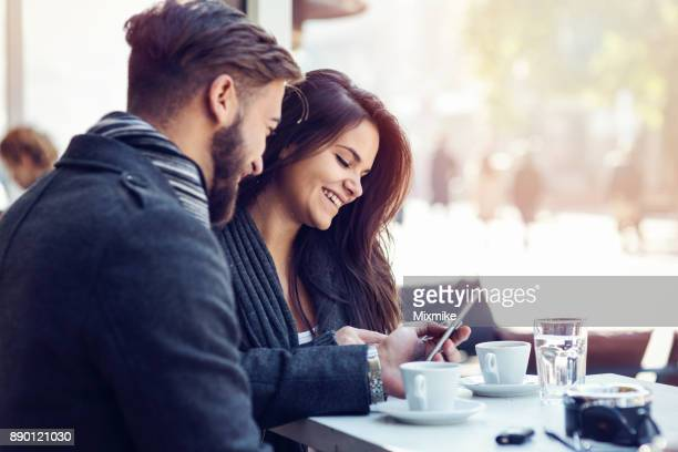 Young couple watching on the mobile phone