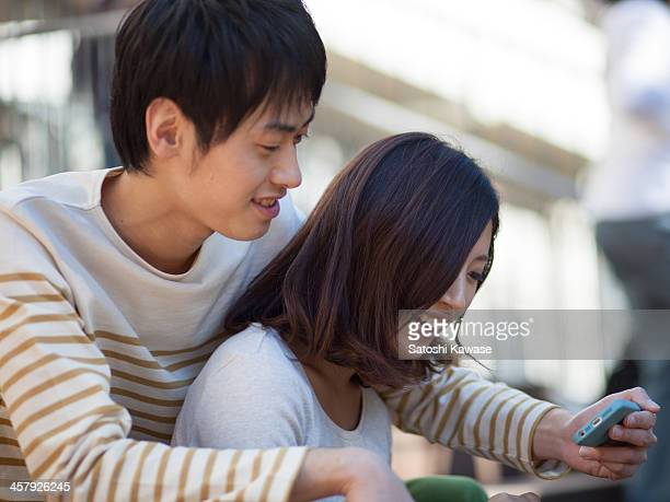 Young couple watching together smartphone screen