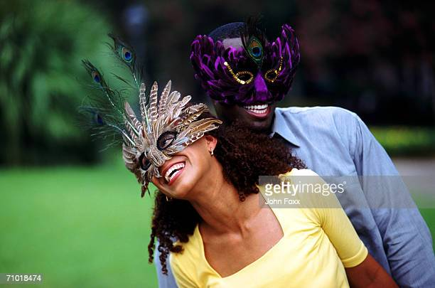 Young couple wearing eye masks, smiling