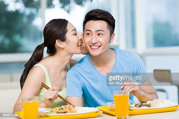 Young couple whispering in restaurant