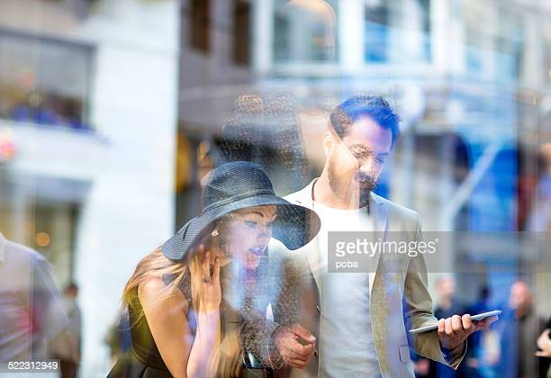 young couple window shopping in the city