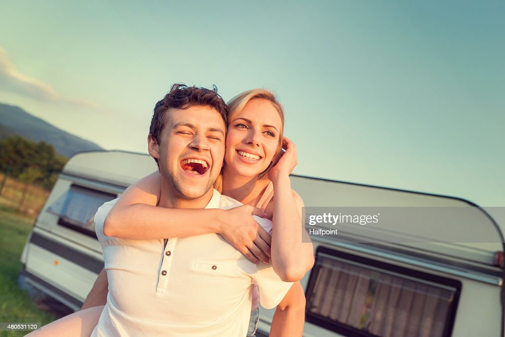 Young couple with a camper van : Stock Photo