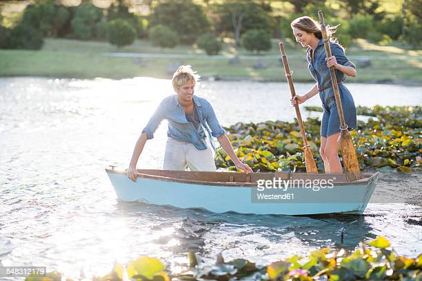 Young couple with a rowing boat on a lake