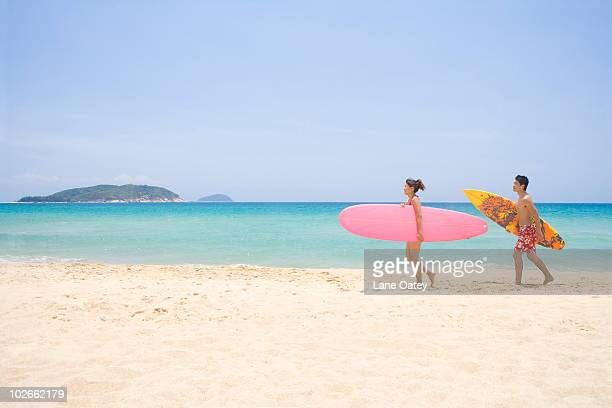 Young couple with a surfboard
