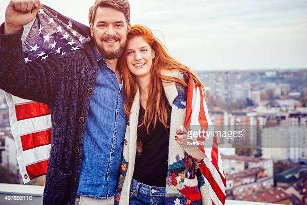 Young couple with American flag.