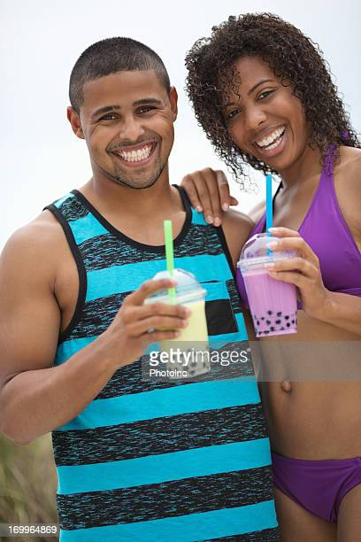 Young Couple With Bubble Tea At Beach