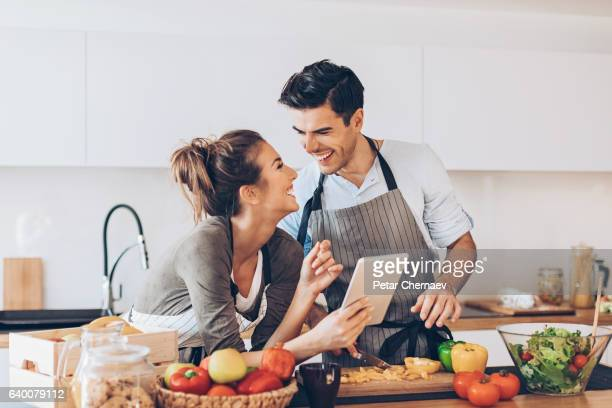 Young couple with digital tablet in the kitchen