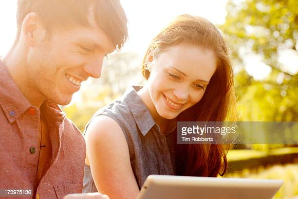 Young couple with digital tablet.