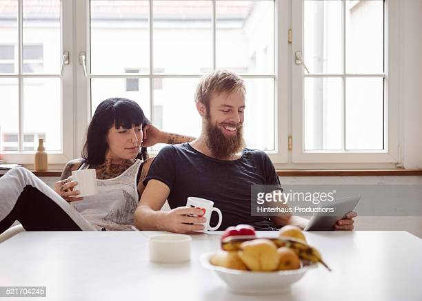 Young Couple With Digital Tablet
