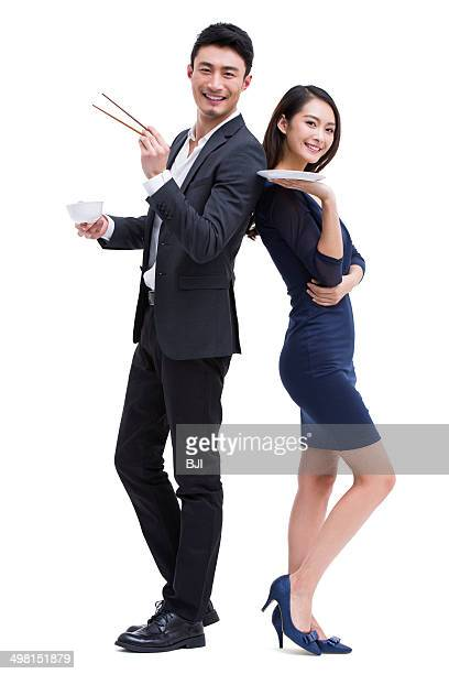 Young couple with eating utensils