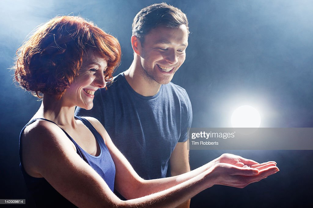 Young couple with glowing light. : Stock Photo