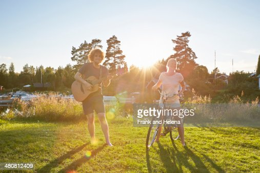 Young couple with guitar and bicycle, Gavle, Sweden