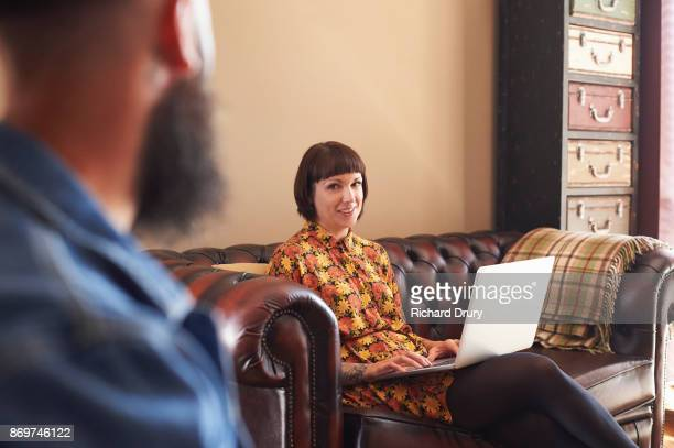 Young couple with laptop in their living room
