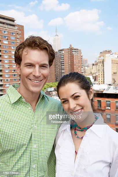 Young couple with Manhattan in background (portrait), Manhattan, New York City, New York, USA