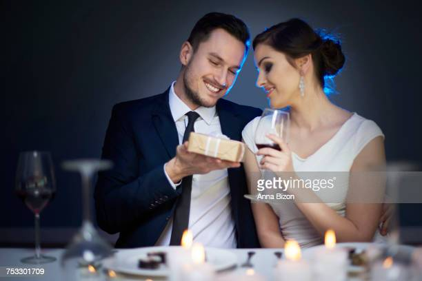 Young couple with present and glass of red wine. Debica, Poland