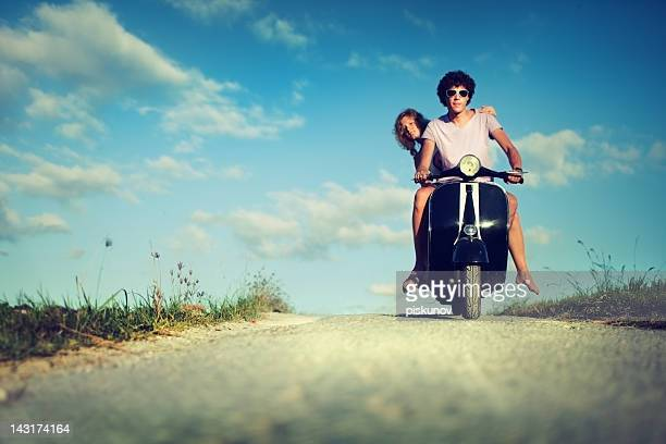 Young Couple with Retrostyle Motorbike