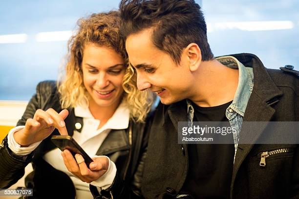 Young Couple with Smart Phone, Commuting, Ferryboat, Bosporus, Istanbul, Turkey