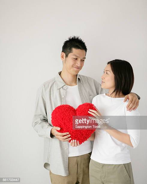 Young Couple With The Cushion Heart