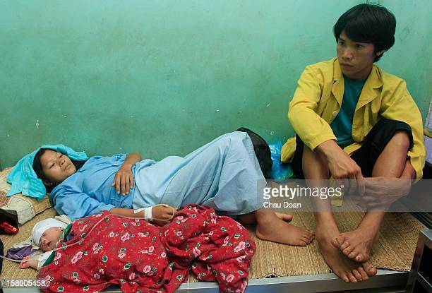 A young couple with their new born baby in Ha Giang hospital
