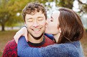 Young couple. Woman kissing man.