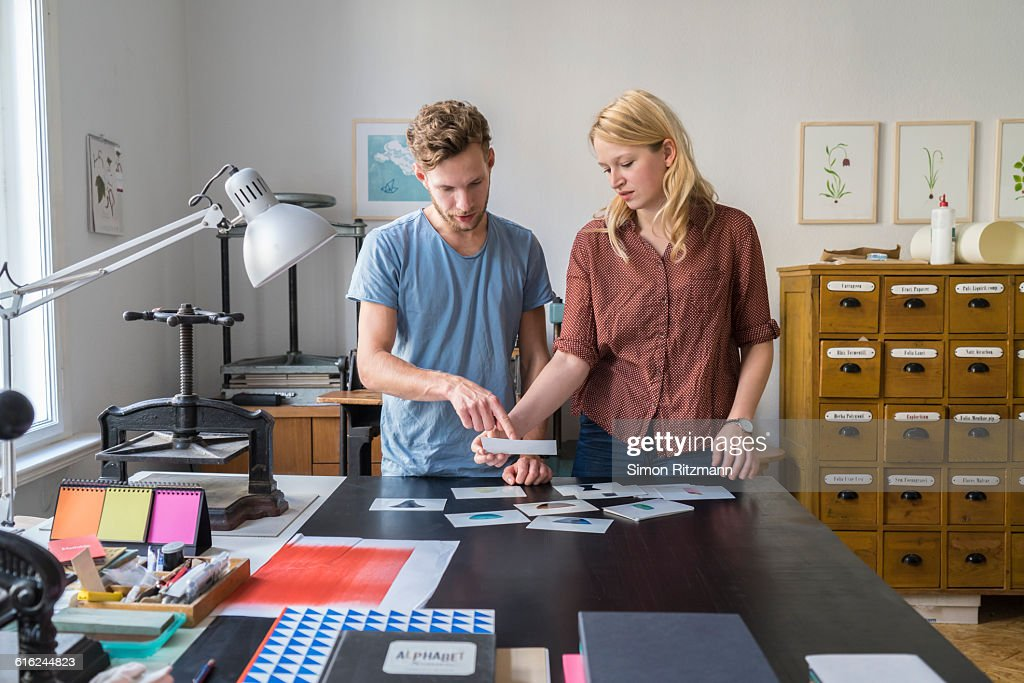 Young couple working together : Stock Photo