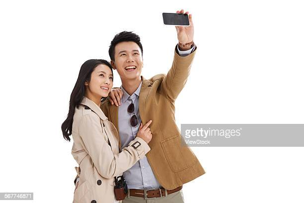 Young couples are using mobile phone autodyne