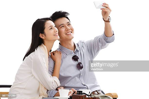 Young couples are using mobile phone camera