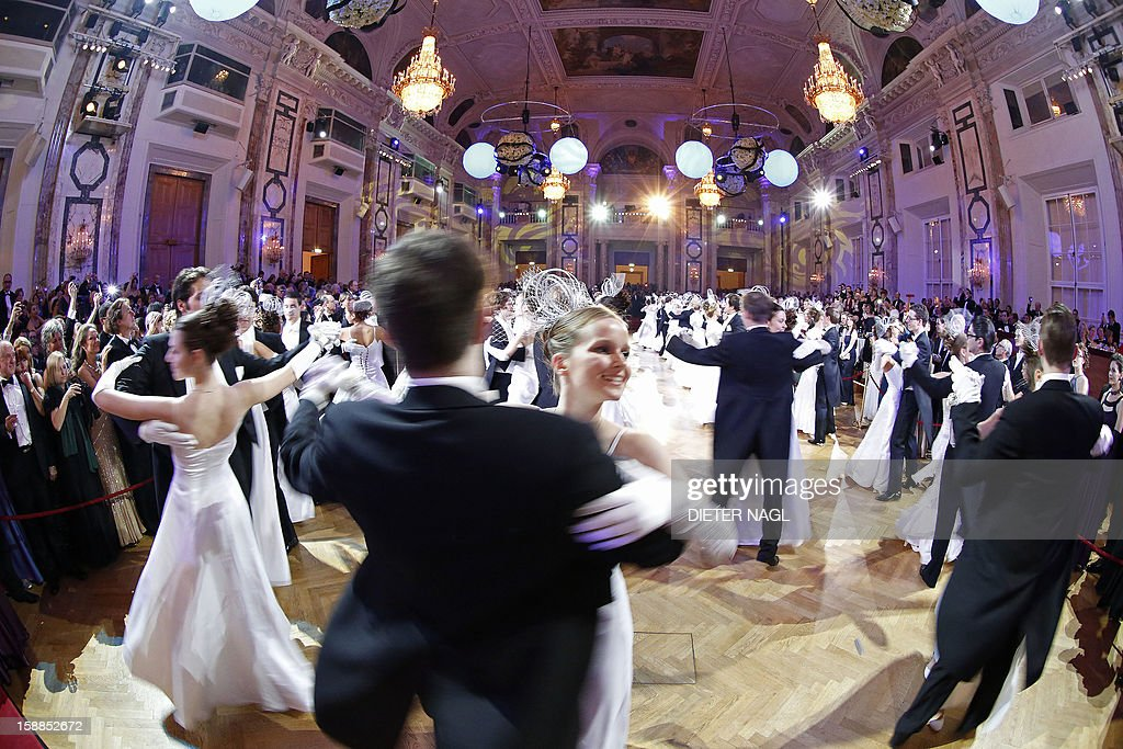 Young couples dance at the 'Le Grand Bal' on December 31, 2012 at the Hofburg Palace in Vienna. AFP PHOTO/DIETER NAGL