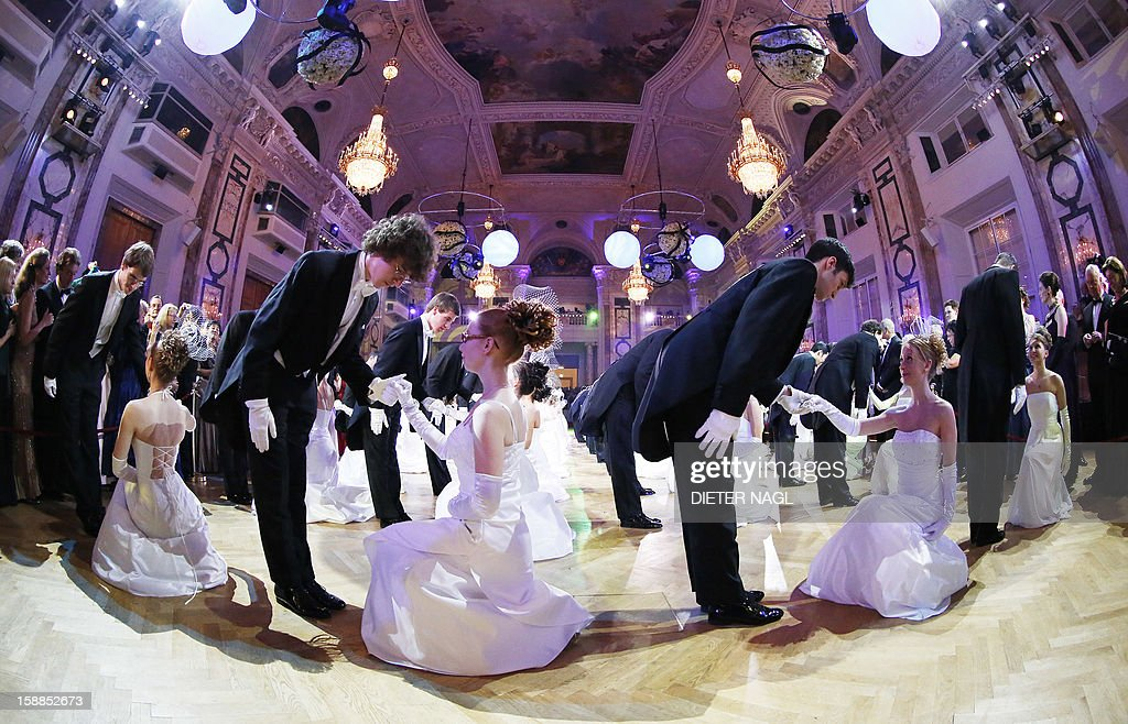 Young couples dance at the 'Le Grand Bal' on December 31, 2012 at the Hofburg Palace in Vienna.
