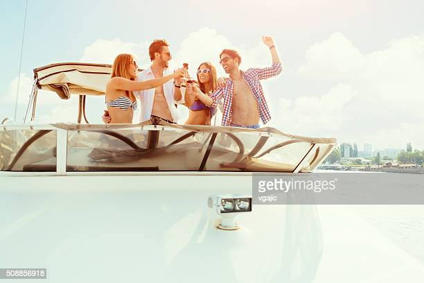 Young Couples Drinking Wine On Yacht.