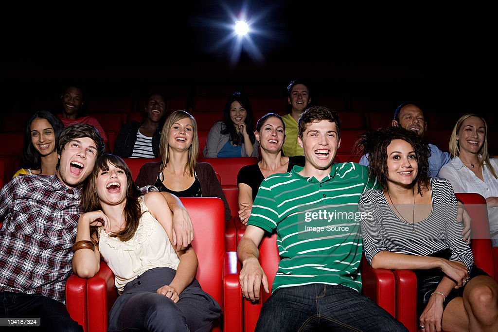 Young couples enjoying a movie
