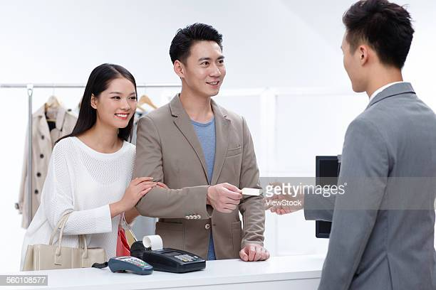 Young couples in the clothing store to buy clothes