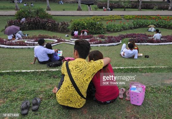 Young couples relax on the bank of Inya Lake as they enjoy Valentines day in Yangon on February 14 2013 Saint Valentine's Day is commonly known as...