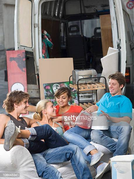 Young couples relax with moving truck