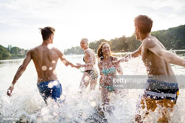 Young Couples Running In Lake