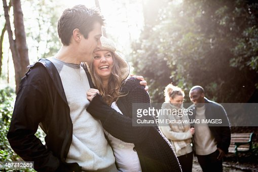Young couples walking through forest : Stock Photo