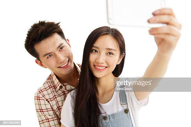 Young couples with a mobile phone camera