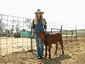 Young cowgirl with 4-H calf on family ranch in Big Timber, Montana