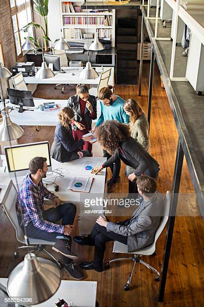 Young creative business people talking in office